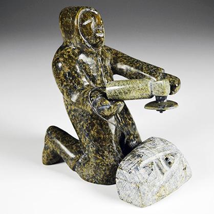 QimirpikPitseolakCarverMakingSculpture
