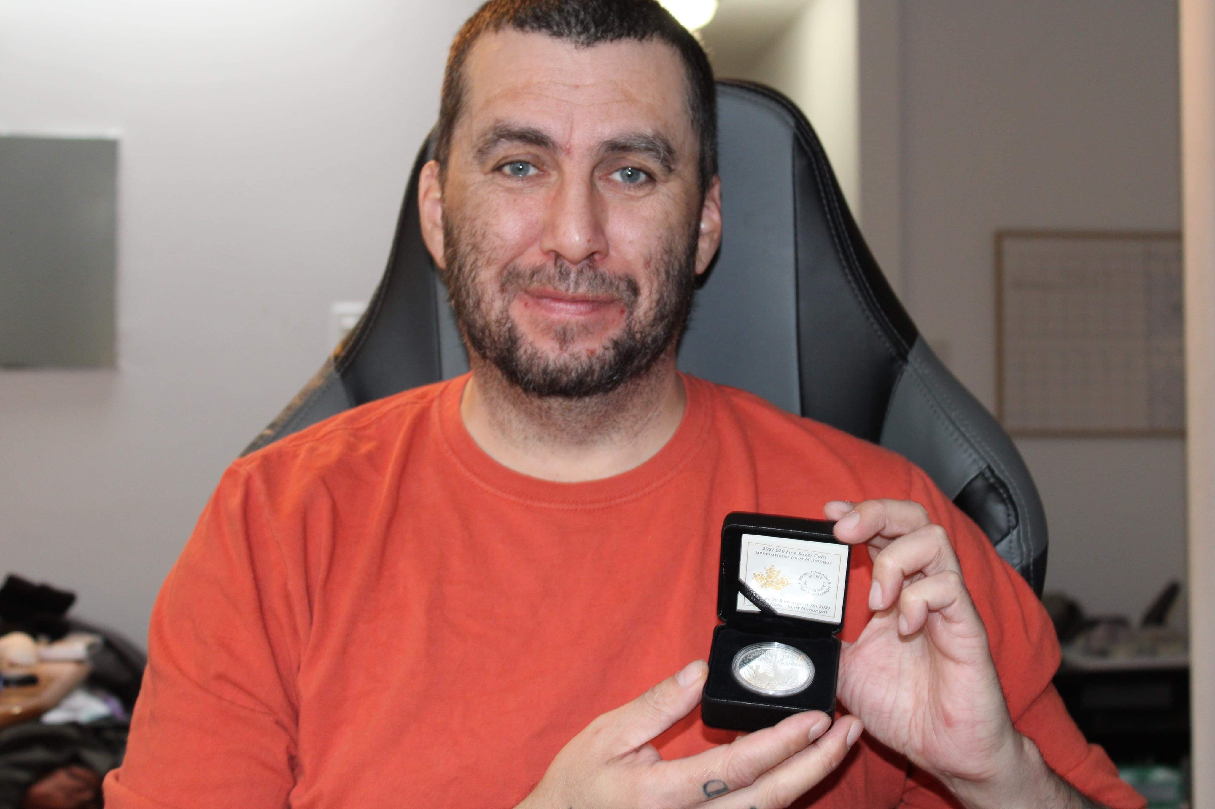 SikoakJason holding coin
